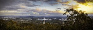 Canberra late afternoon with sun over mountains.
