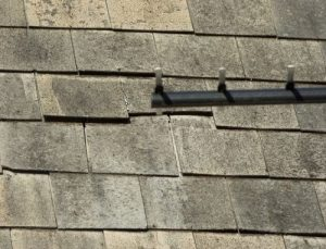 asbestos roof shingles now loose
